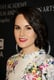 Michelle Dockery opted for a hot pink lipstick to complement her colorful frock at the BAFTA LA TV Tea before the 2013 Emmys.