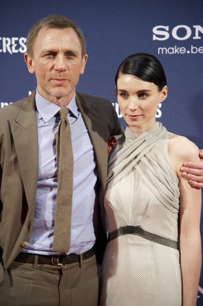 Daniel Craig pulled Rooney Mara in for an affectionate photo at the Madrid premiere of The Girl With the Dragon Tattoo.