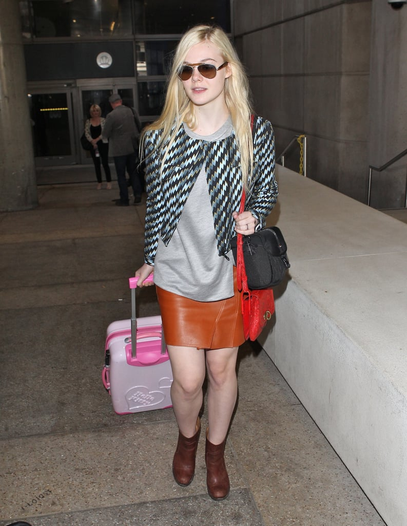Elle Fanning looks every bit the It-girl in brown leather.