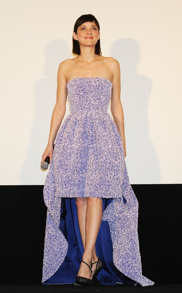 Marion Cotillard donned a floral-textured strapless gown from the Christian Dior Pre-Fall 2013 collection, which also featured a high-low hem and a contrasting blue satin lining. While the Rust & Bone actress didn't do much more in the way of styling — other than to pair the look with black Dior pumps — she furthered her loyalty to the label with this Tokyo premiere look.