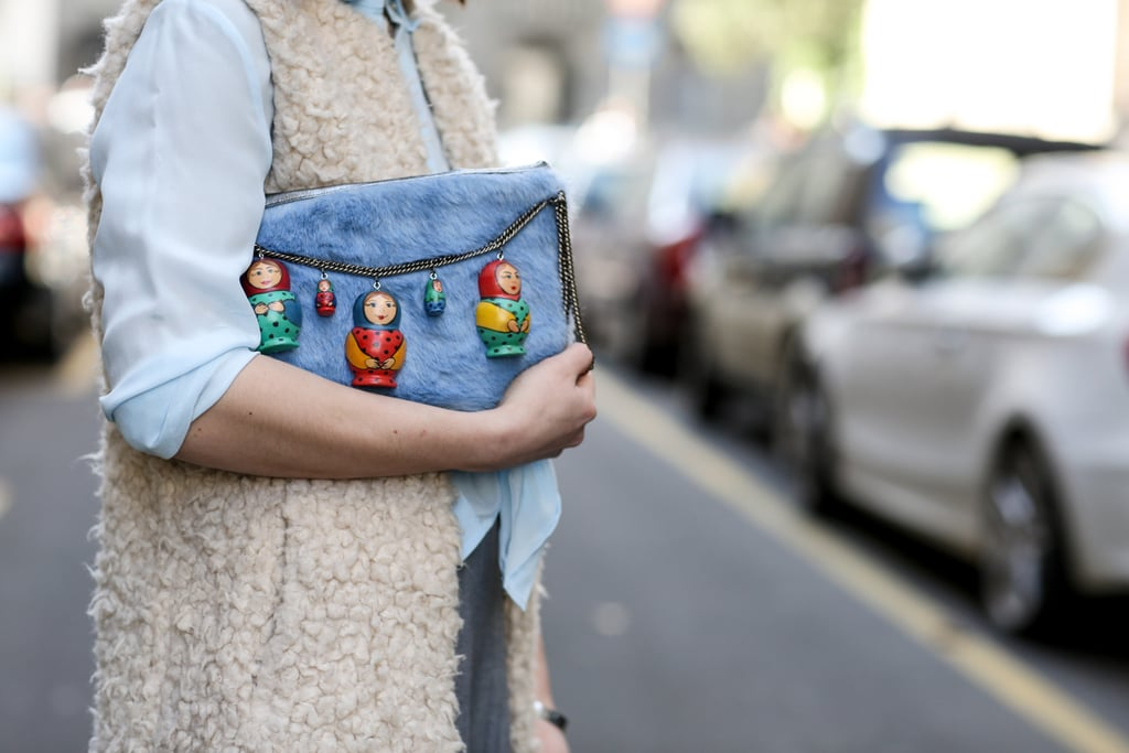 This clutch comes decked out with little figurines.