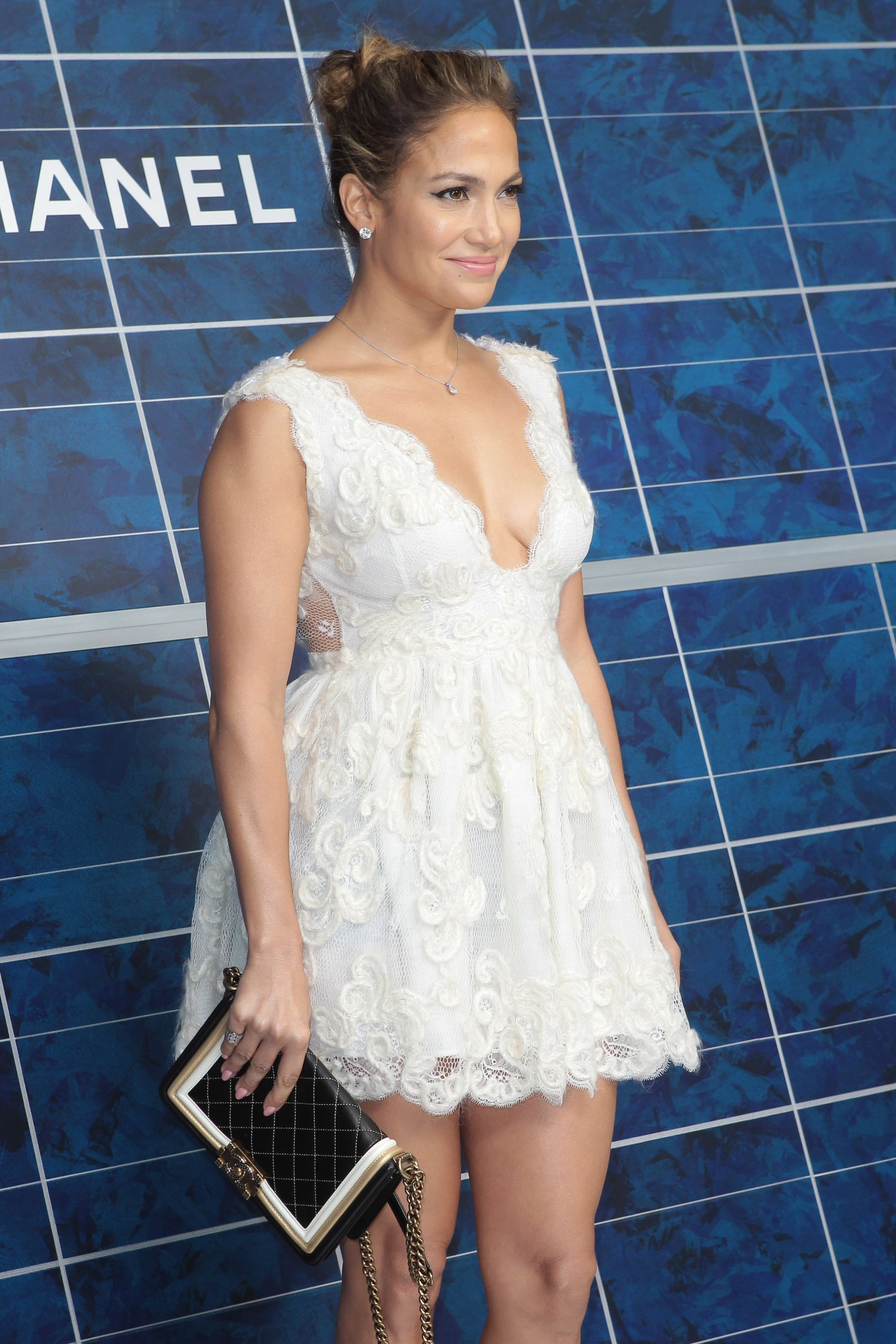 Jennifer Lopez posed in a white lace dress during Chanel's photocall for Paris Fashion Week.