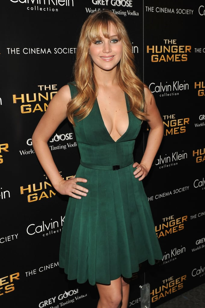 A sexier neckline and cinched waist flatter Jennifer's figure perfectly.