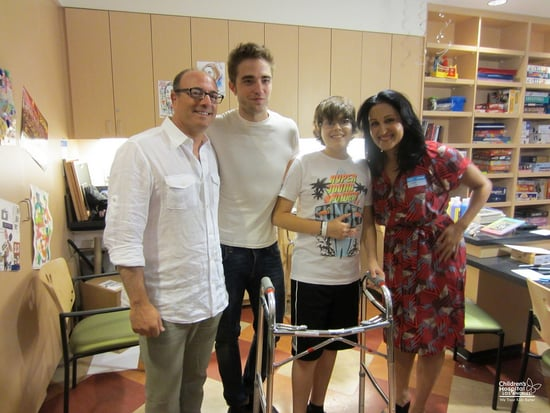 Robert-Pattinson-snapped-pictures-fans-during-his-children