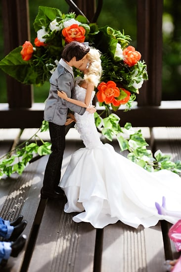 They kiss! Photo by BdG Photography via Rock n Roll Bride