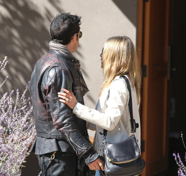 Jennifer Aniston showed off her massive engagement ring for the first time as she and fiancé Justin Theroux wandered around Santa Fe on October 6.