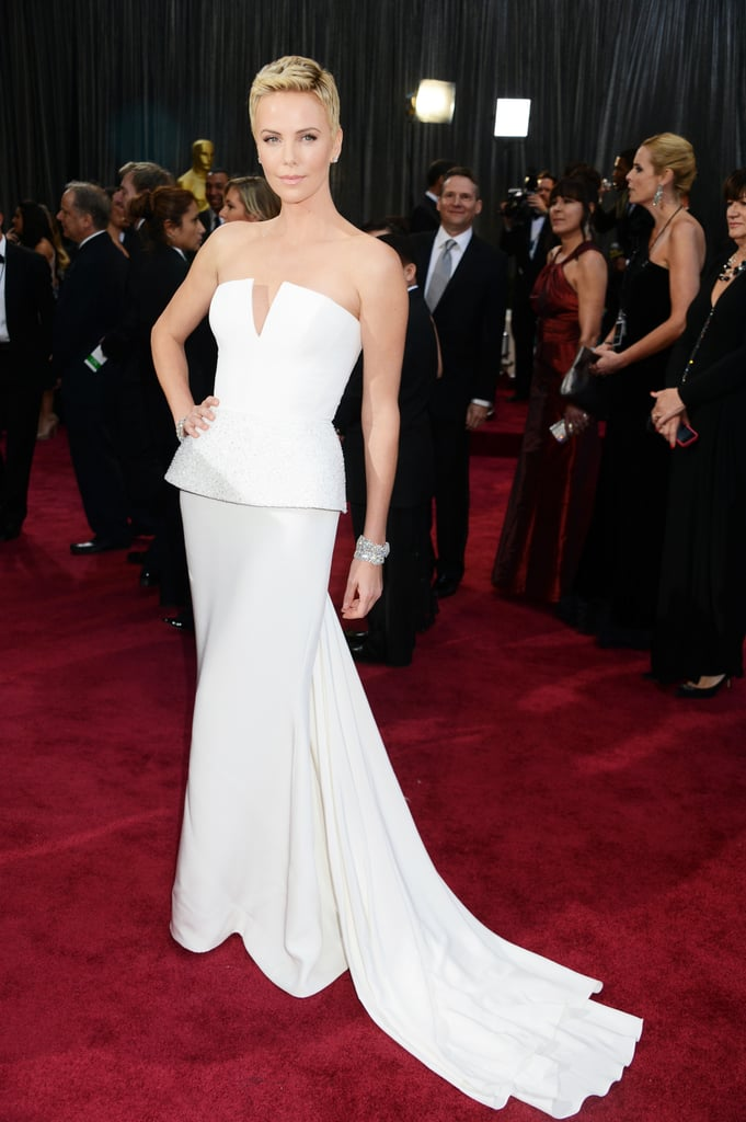 Charlize Theron also chose a strapless white Christian Dior Haute Couture gown for the 2013 Oscars, but hers was a column with an embellished peplum and a deep-V bodice.