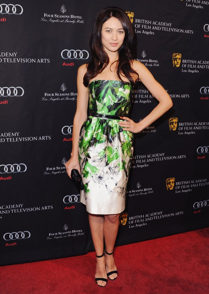 Olga stood out in a green printed strapless cocktail dress and black ankle-strap sandals at the BAFTA tea party in Beverly Hills.