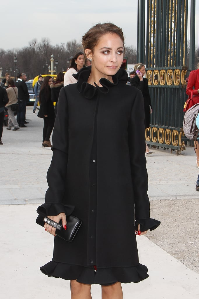 Nicole Richie wore a long black coat outside the Valentino show in Paris in March.