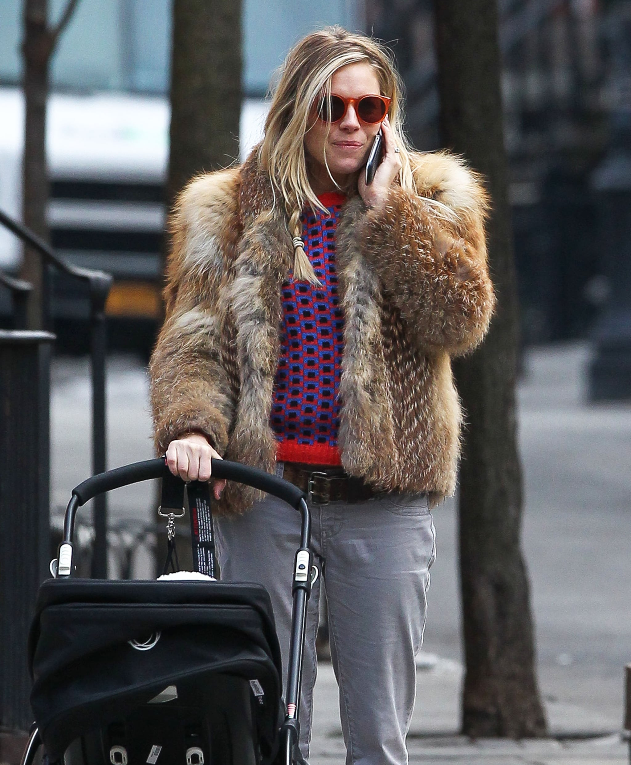 Sienna Miller talked on the phone while strolling with Marlow Sturridge.