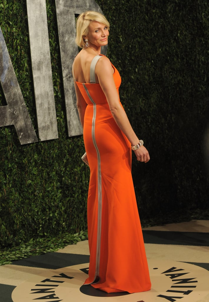 A look at Cameron Diaz from behind in her Victoria Beckham orange dress.