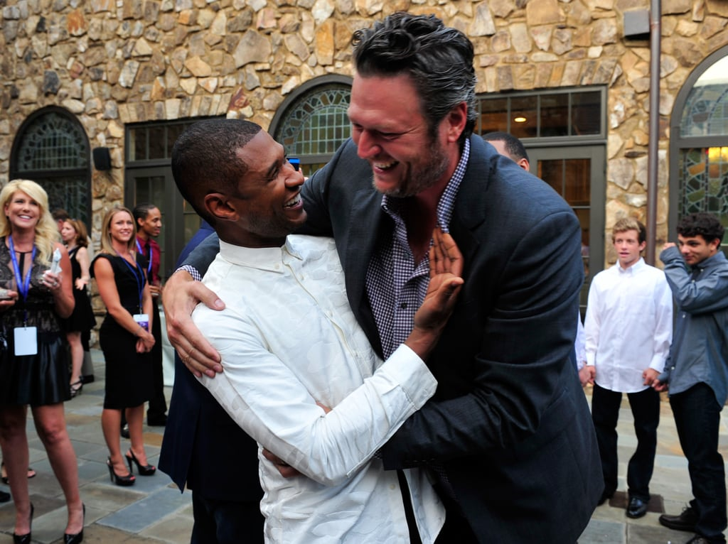 He shared a cute bro-ment with his fellow Voice coach Blake Shelton at a fundraiser for his charity in July 2014.