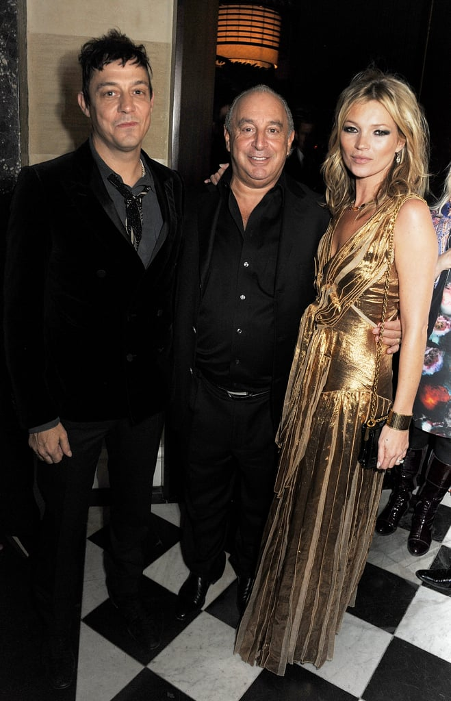 Jamie Hince and Kate Moss posed with Philip Green in London.