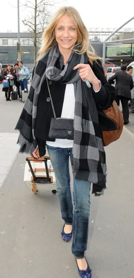 Cameron Diaz Arrives at Heathrow Airport in a Burberry Plaid Wrap, Chanel Bag, and Lanvin Leopard Flats