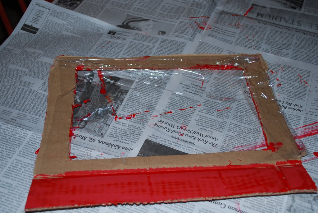 """Paint the """"windshield"""" the same color as the racing stripes and attach a piece of plastic wrap to the inside of the boarder."""