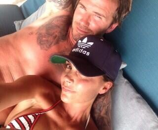 """Victoria shared a snap of herself lounging with husband David and wrote, """"Having a wonderful day with my family."""" Source: Twitter user victoriabeckham"""