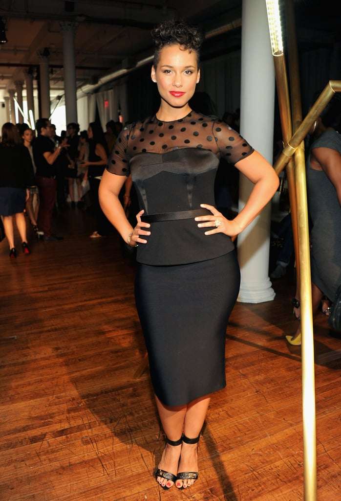 Alicia Keys posed for photos at the Jason Wu Spring 2014 show on Friday.