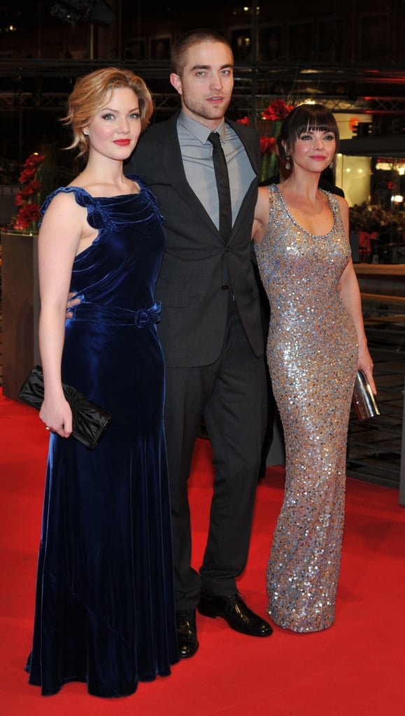 The trio walked together down the carpet.