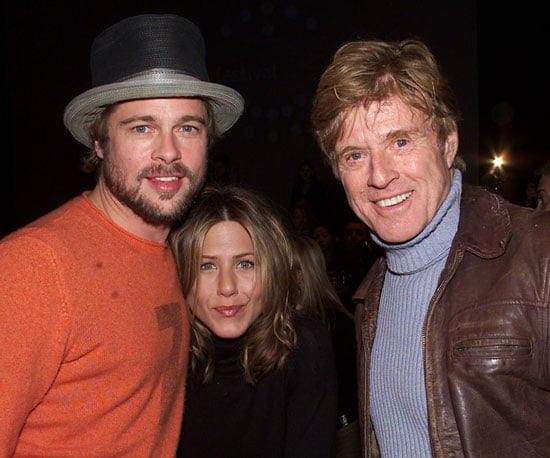 Robert Redford posed with Brad Pitt and Jennifer Aniston before the premiere of The Good Girl during the 2002 festival.