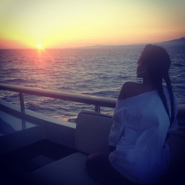 Rihanna watched the setting sun on a yacht.  Source: Instagram user badgalriri