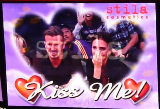 David Beckham and Victoria Beckham get shy on the Kiss Cam.