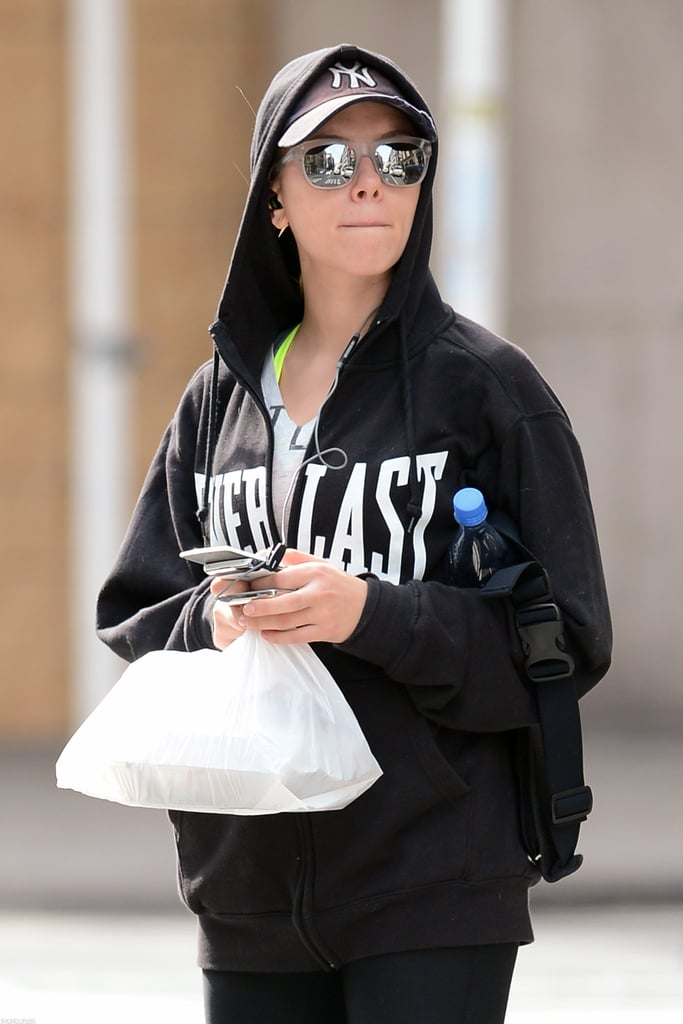 Scarlett Johansson wore a Yankees hat and a hooded sweatshirt over her workout gear in NYC.
