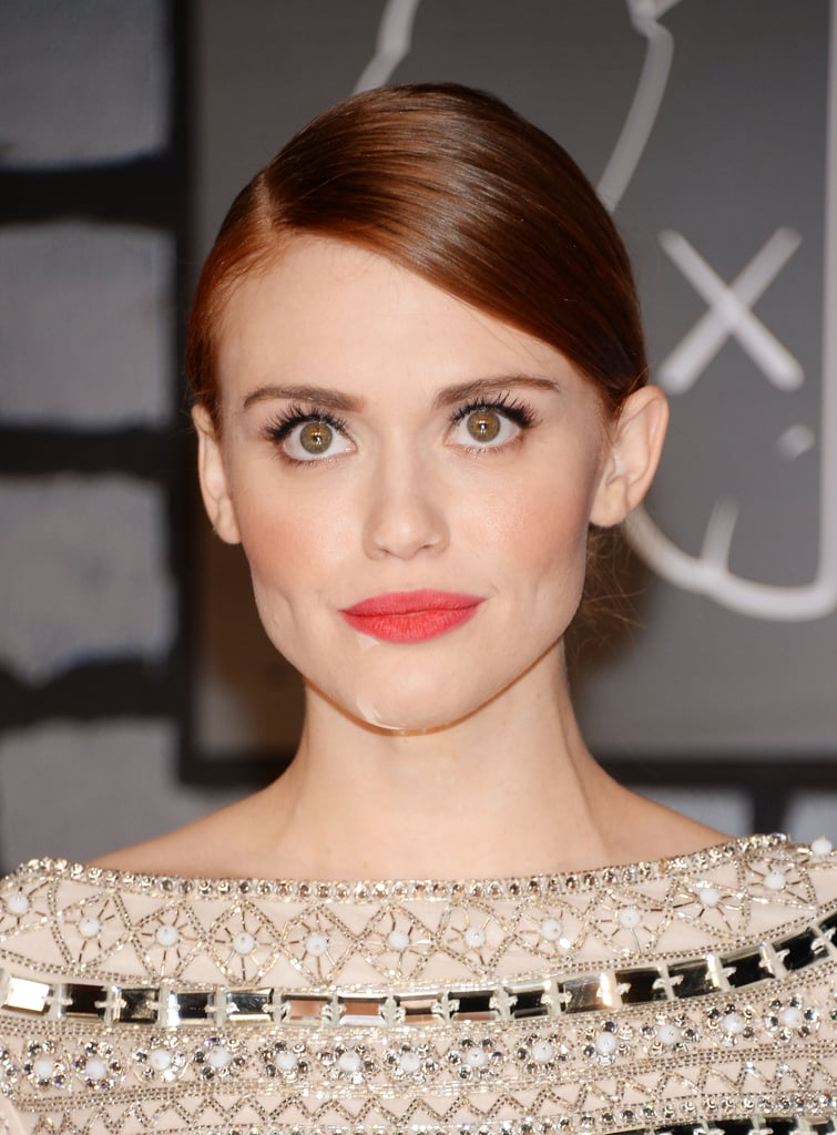 Holland Roden wore her red locks slicked back into a bun and added a tangerine lip color for extra oomph.