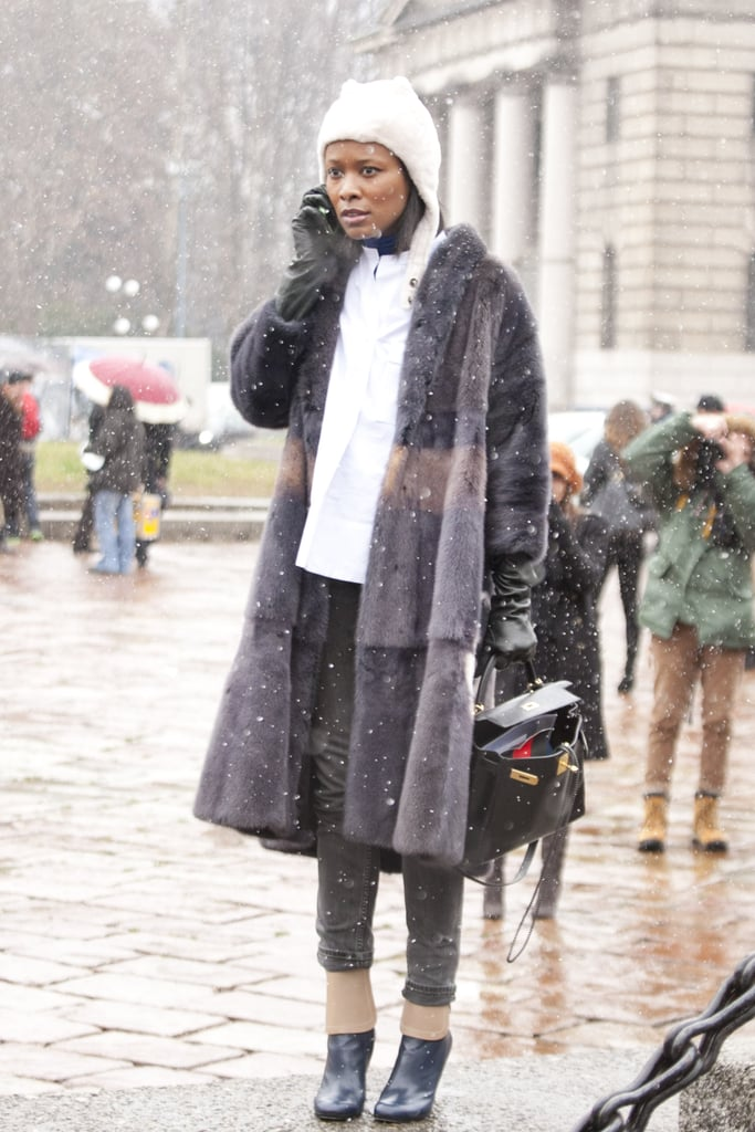 Shala Monroque accessorized a soft fur coat with a classic structured Hermès.