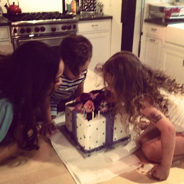 Harlow and Sparrow Madden helped their grandma blow out the candles on her birthday cake. Source: Instagram user joelmadden
