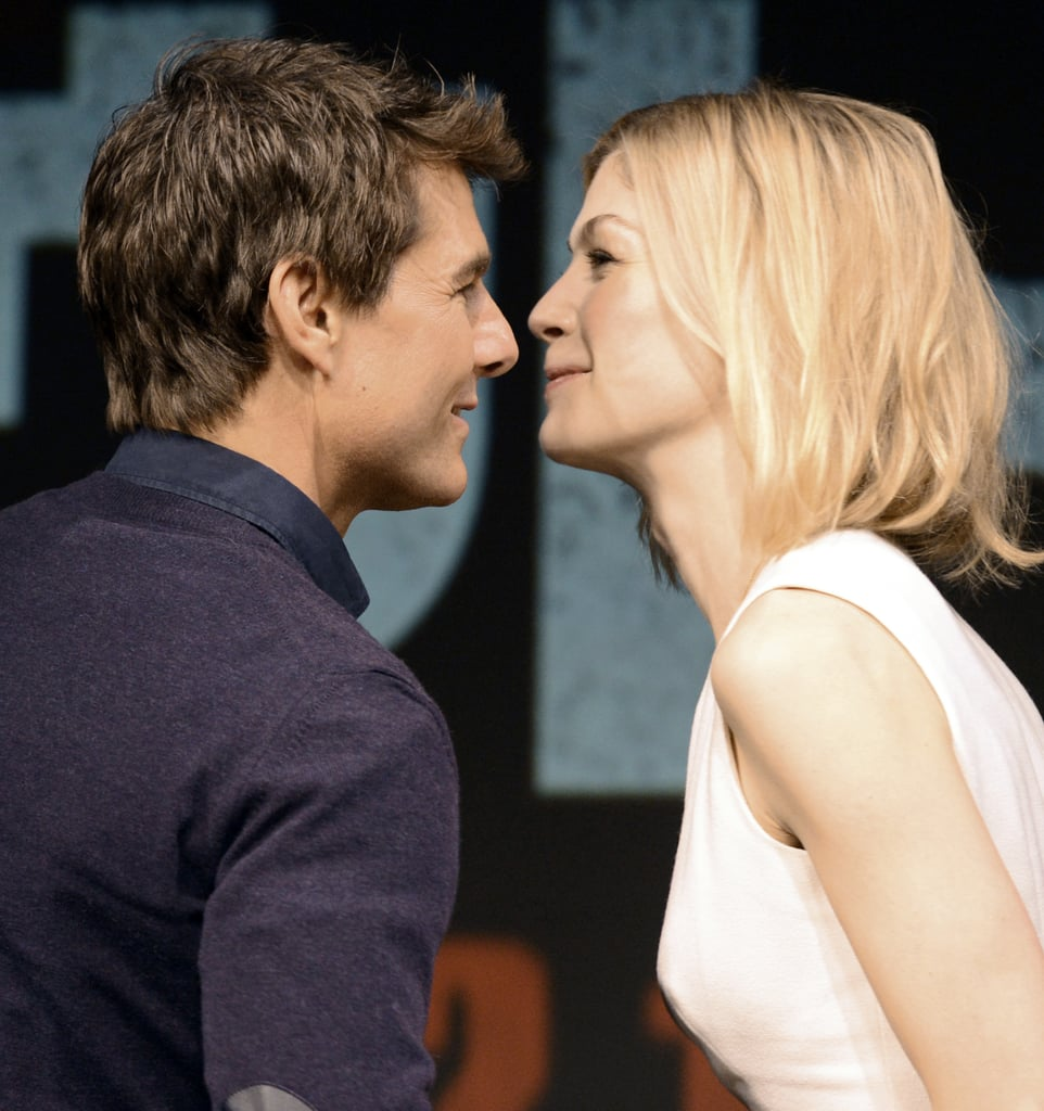 Tom Cruise smiled with Rosamund Pike.