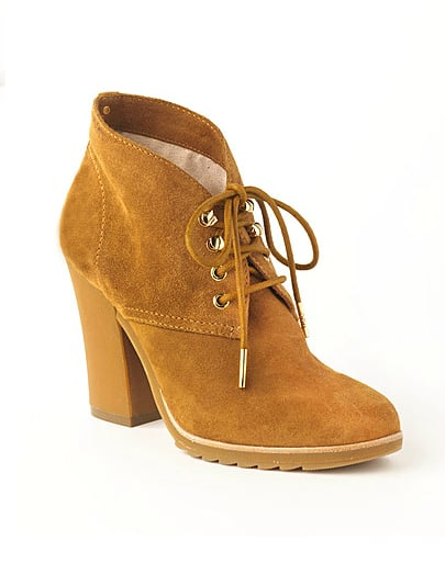 Embrace the cozy-chic cabin vibe when you pair these Michael Michael Kors Elliot Suede Lace-Up Ankle Boots ($140, originally $175) with easy denim and a plaid button-down.