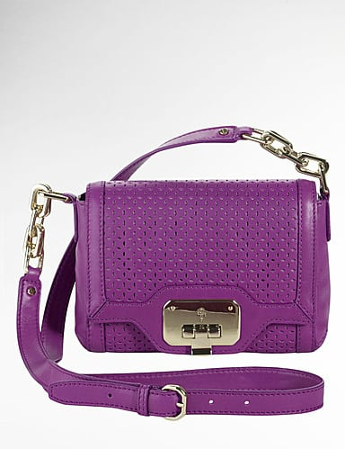 We love the super soft leather, perforated detailing, and punchy color.  Cole Haan Vintage Valise Marisa Crossbody Bag in Purple ($198)