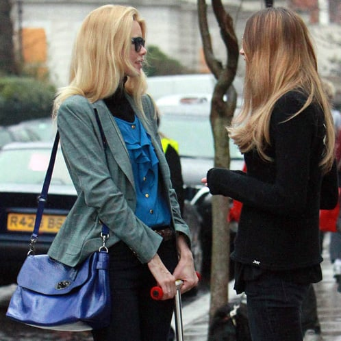 Elle Macpherson and Claudia Schiffer on School Run With Patent Blue Shoulder Bag