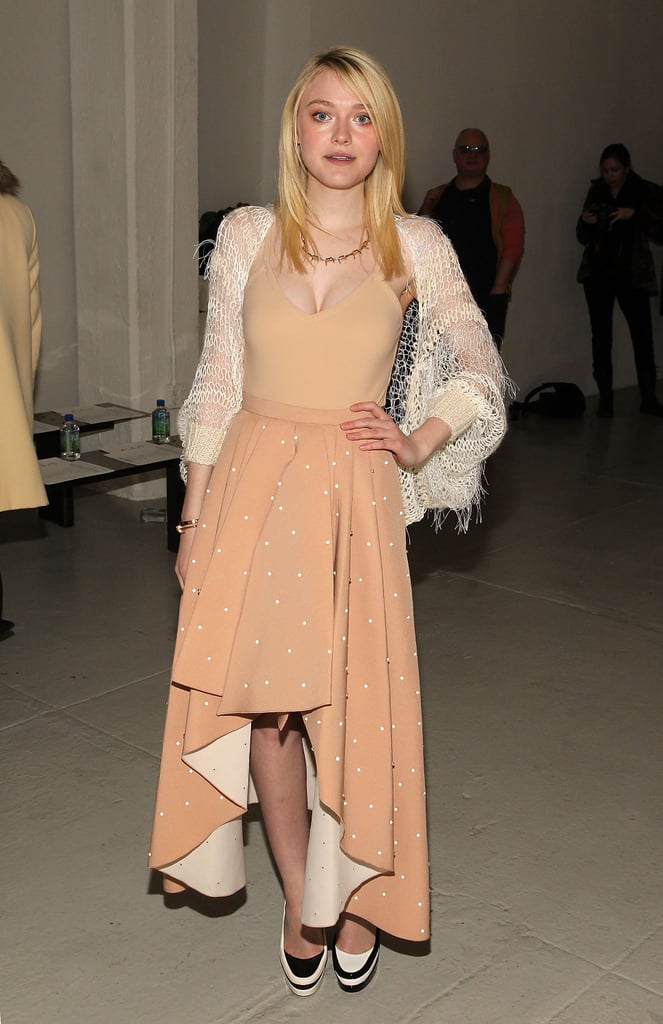 Dakota Fanning posed for photos at the Rodarte runway show on Tuesday evening.