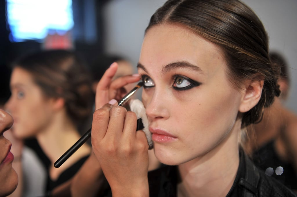 """The makeup, conjured up by MAC artist Polly Osmond, focused on a bold, black eye. The rest of the face was kept natural, save for some heavy contouring that gave models """"a sucked-in, sculpted look,"""" according to Osmond. Keep checking back for more backstage beauty!"""