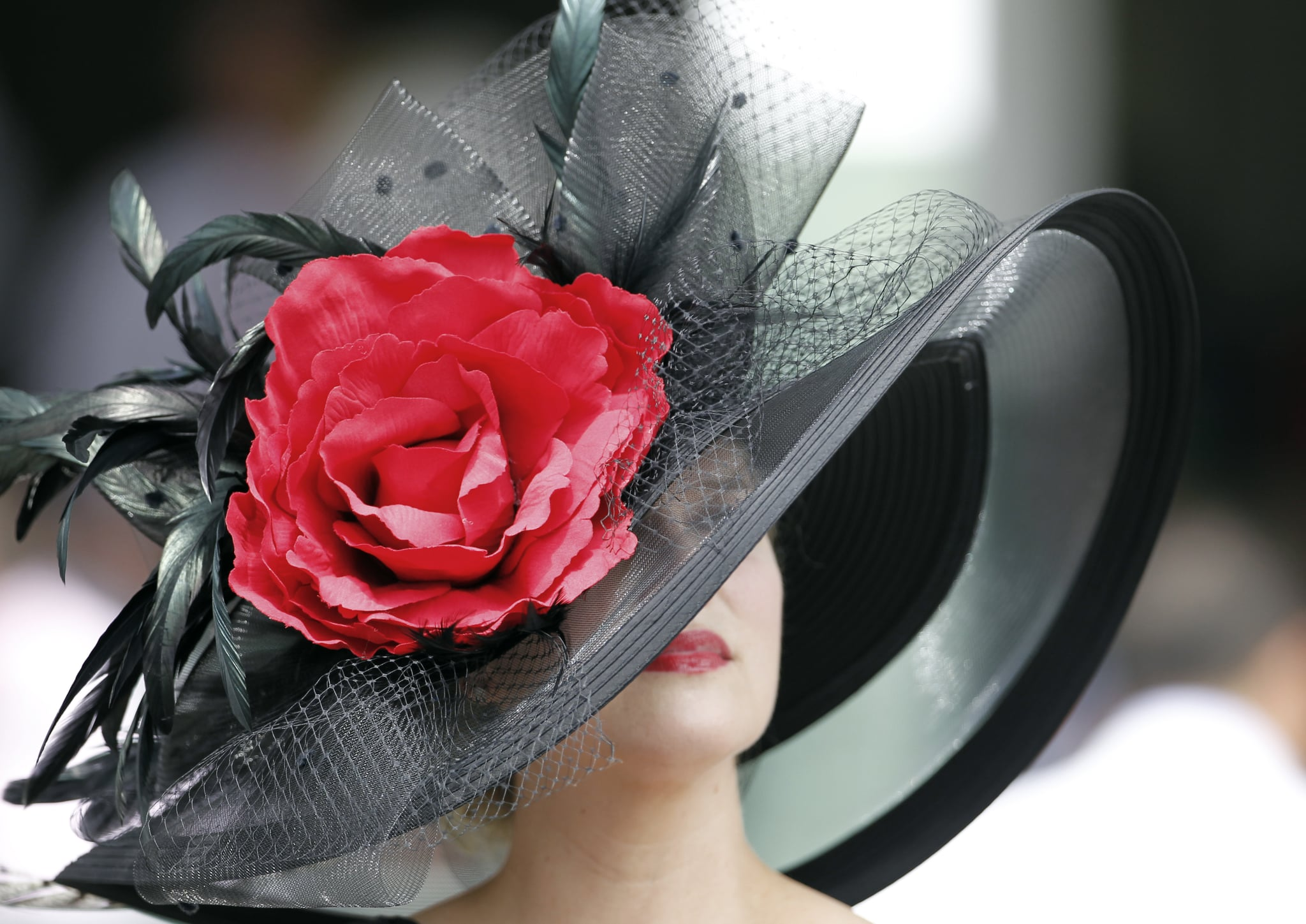 A woman went dramatic with her black and red hat in 2012.