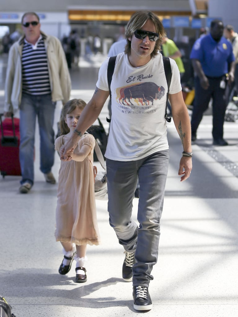 Keith Urban held his daughter Sunday Rose's hand at LAX as they headed to Cannes to join mom Nicole Kidman.