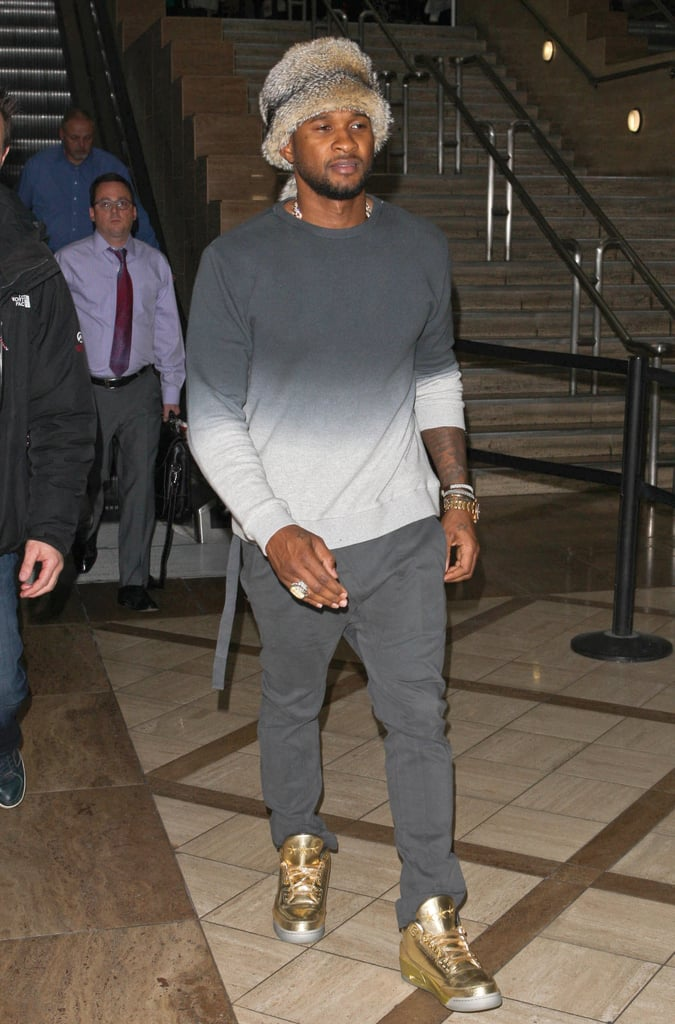 Usher wore a fur hat when he arrived at LAX on Thursday.