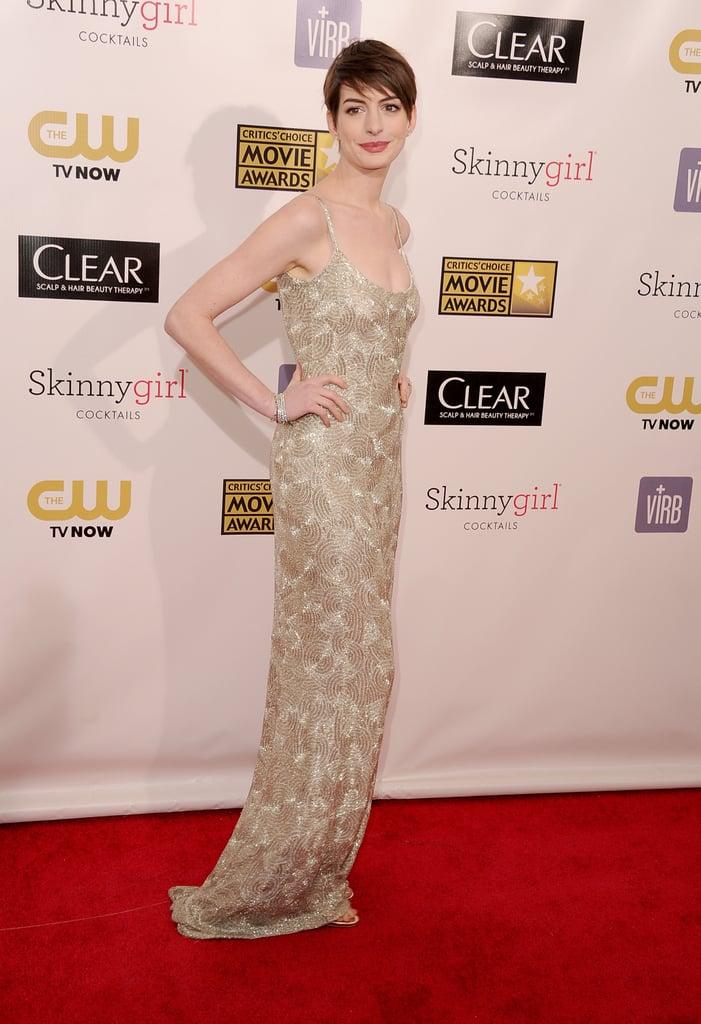 Anne Hathaway posed in a metallic Oscar de la Renta gown.