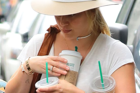 Hilary Duff Struggling To Hold Three Starbucks Is All Of Us