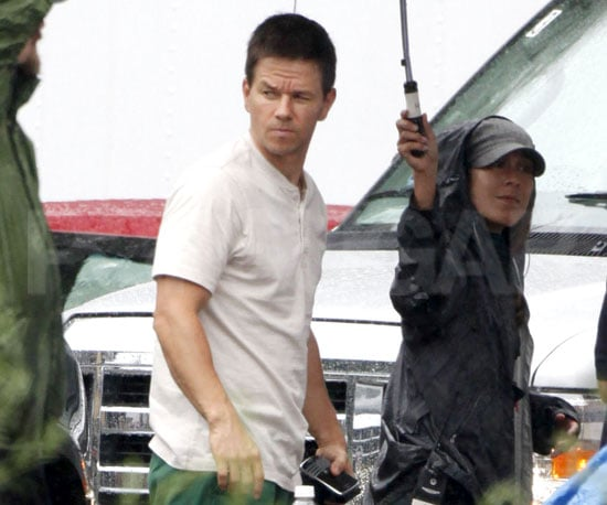 Photo Slide of Mark Wahlberg Staying Dry on the Set of The Fighter