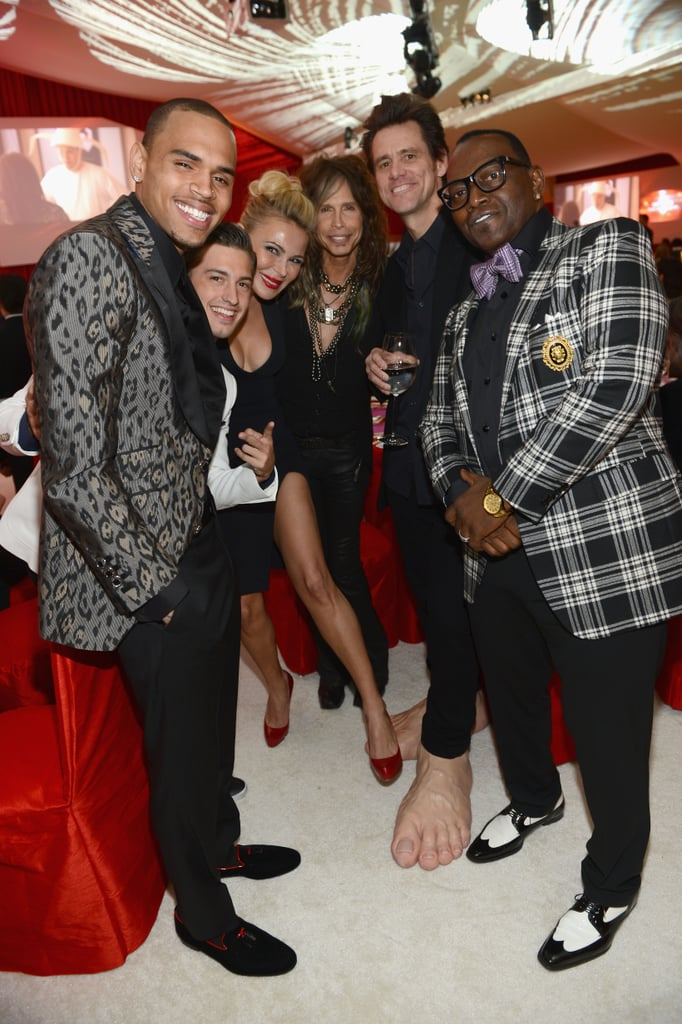 Jim Carrey and Randy Jackson hand fun with friends at Elton John's party on Oscar night.
