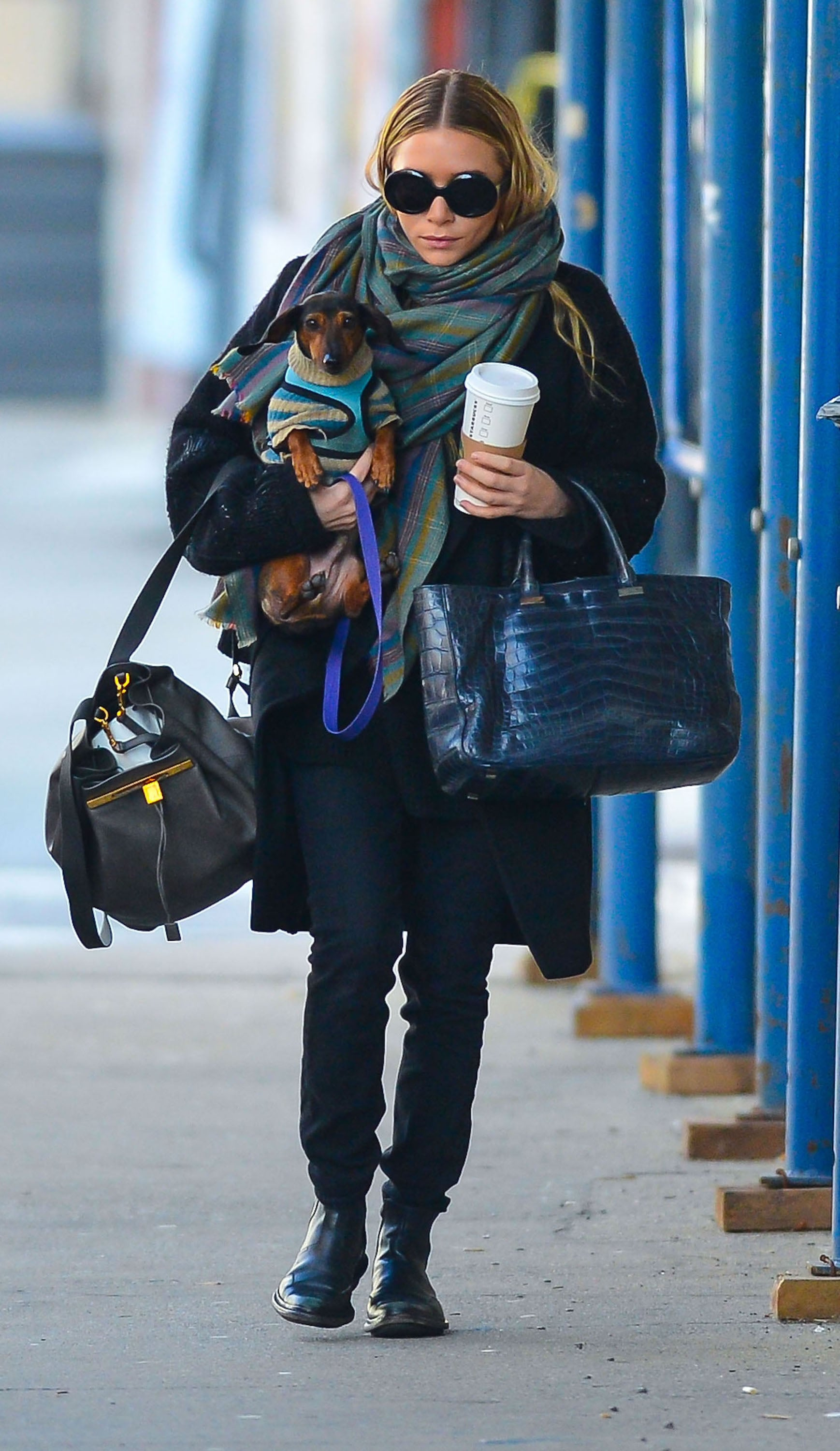 Ashley Olsen had her hands full on a walk in NYC.