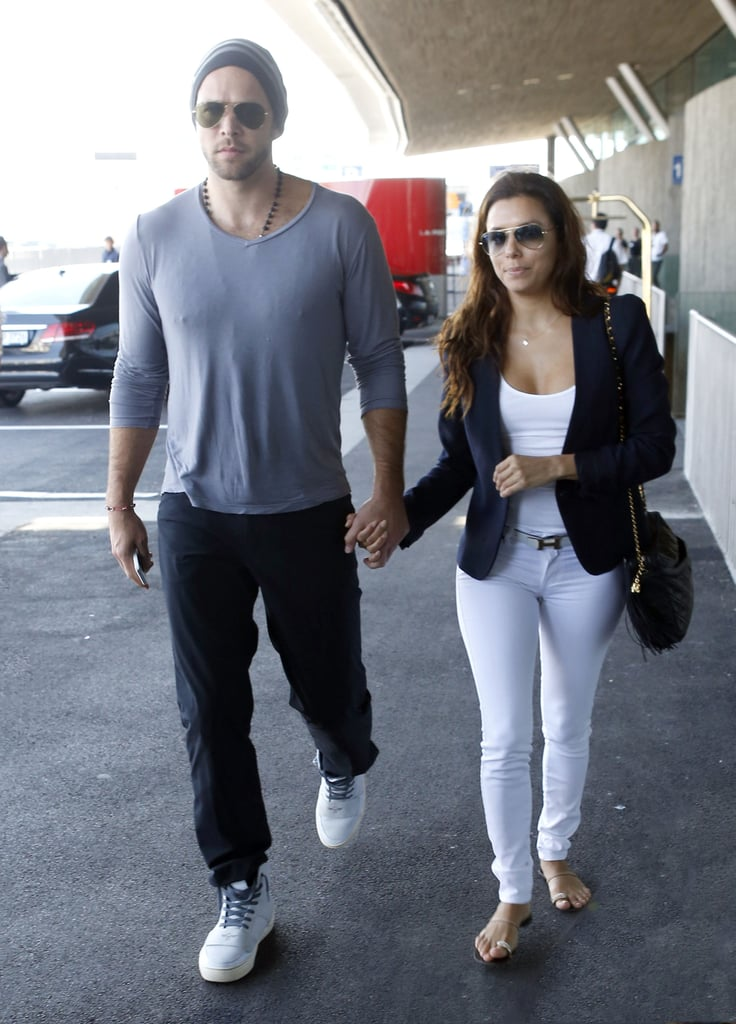 Eva Longoria's white look got a polished and preppy finish from her blue blazer and classic black bag.