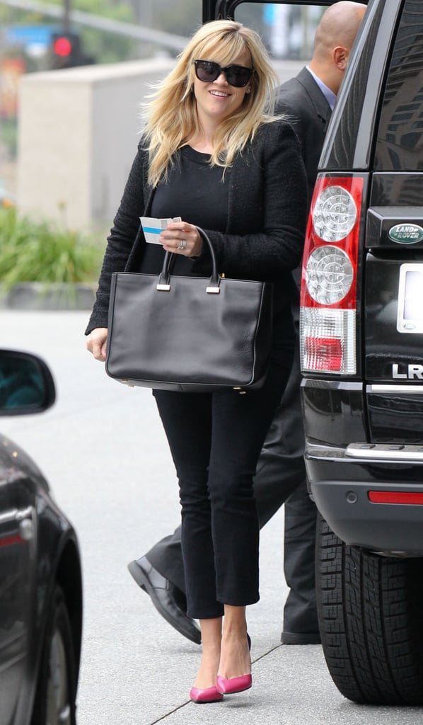 Reese Witherspoon arrived at a business meeting.