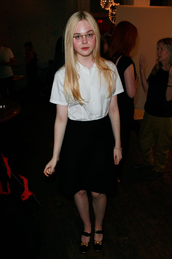 Elle Fanning played the part of schoolgirl — in the chicest way possible — by pairing monochromatic separates for a classic feel. Her clear-lens glasses also injected a scholarly vibe.