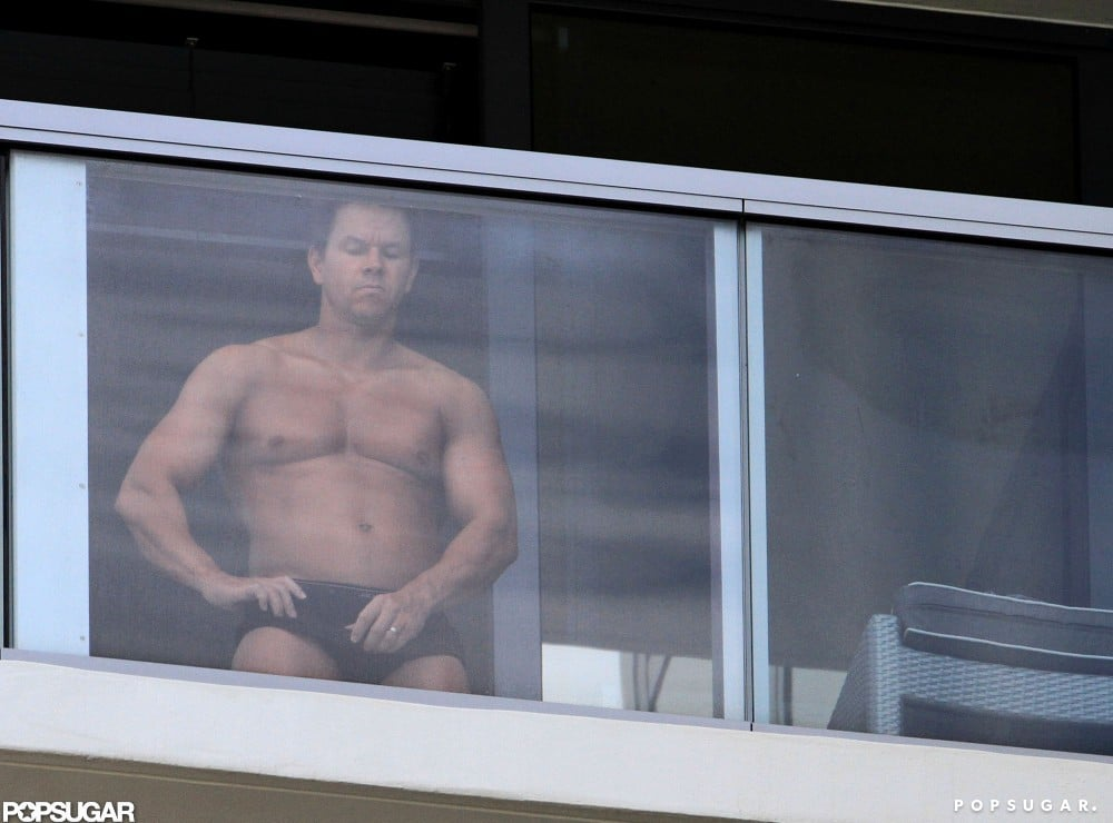 Mark Wahlberg stood on his hotel balcony shirtless in Miami.