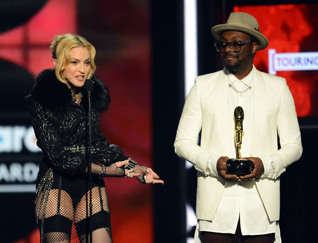 will.i.am stood by as Madonna accepted her award.
