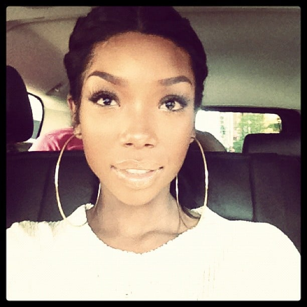 Brandy showed off her huge hoop earrings. Source: Instagram user 4everbrandy