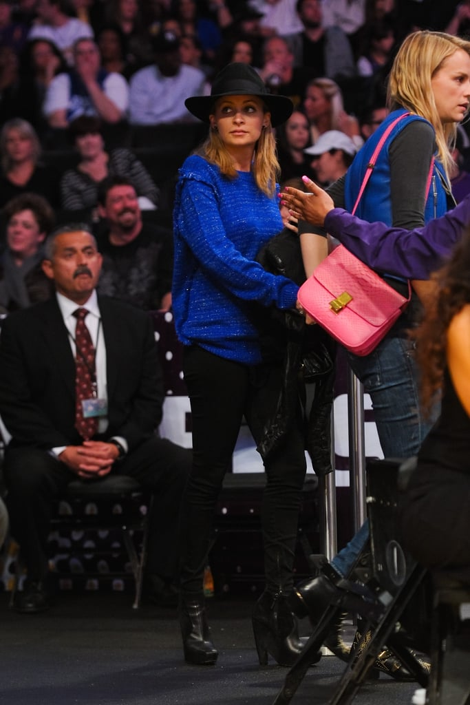 Nicole Richie stayed slightly incognito at a March 2012 Lakers game in a wide-brimmed wool hat. Her bright blue sweater is probably what tipped off the cameramen.